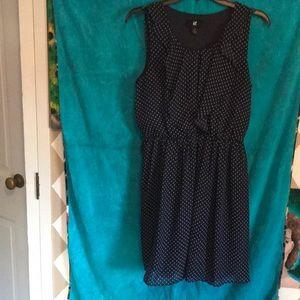 Navy polka dot dress with ruffles